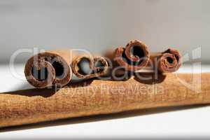 Four cinnamon sticks in the fifth from the end, daylight