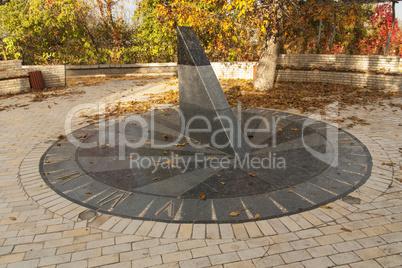 Sun clock marble sundial in Kiev Kyiv Ukraine photo