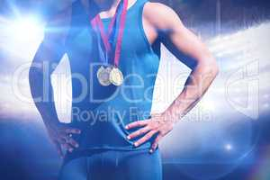 Composite image of portrait of sportsman chest with medals