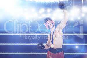 Composite image of boxer wearing gold medal performing boxing st