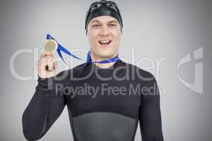 Composite image of swimmer showing his gold medal