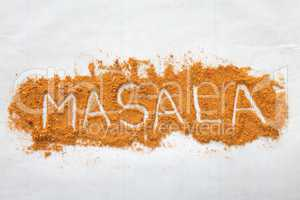 Masala text font written in negative with spices