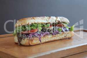 Steak meaty sandwich filled with vegetables