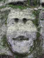Mossy Bizarre Stone Heads - Rock Sculptures