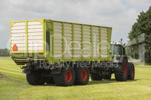 transport of cut grass with tractor and loader wagon
