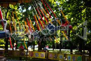 Swing seat carousel at amusement ride