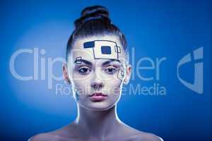 Closeup portrait of a lovely girl with creative makeup over blue background