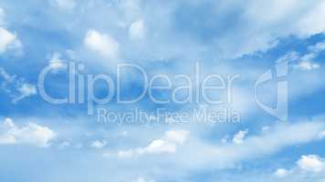 bright blue cloudy sky background