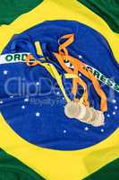 Gold medals on brazilian flag