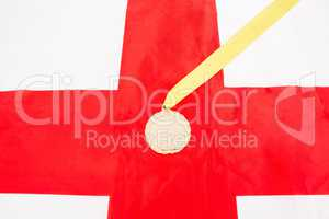Close-up of gold medal on english flag