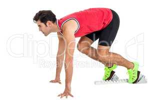 Confident male athlete in ready to run position