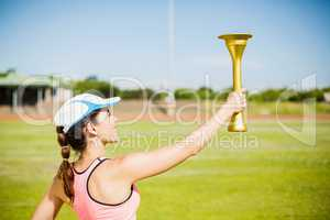 Female athlete holding a fire torch