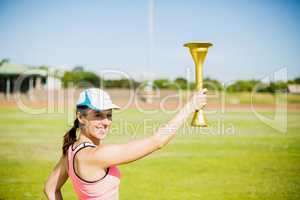 Happy female athlete holding a fire torch