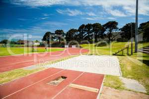 Long jump sand pit on running track