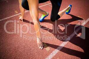 Female athlete in ready to run position