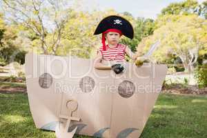 Facing view of boy dressing up as pirate