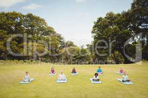 Distant view of children doing yoga