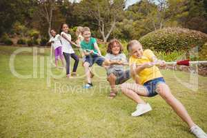 Children pulling a rope in tug of war