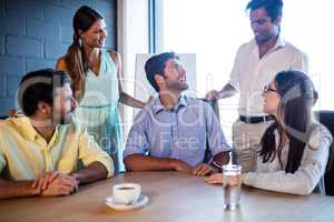 Coworkers interacting around a table