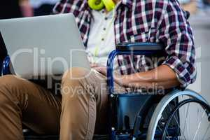 Designer in a wheelchair with a computer