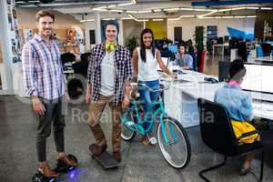 Hipsters with bicycle, skate and smart board