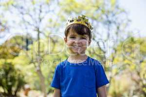 Boy wearing a crown smiling at camera