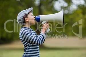 Boy speaking on megaphone
