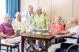 Seniors with wheelchair and walking aid