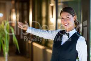 Portrait of smiling waitress welcoming