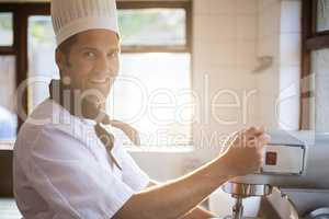 Portrait of chef blending the batter in mixing blender