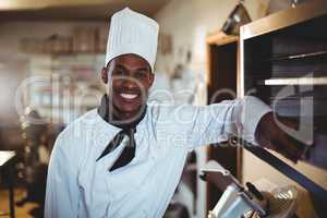 Portrait of smiling head chef
