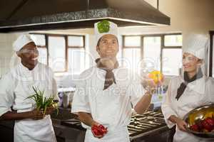 Chef playing with vegetables