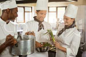 Chefs talking while preparing food