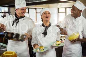 Chefs preparing a dessert