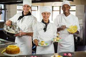 Portrait of chefs preparing a dessert