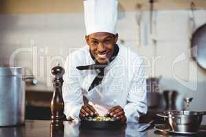 Portrait of smiling chef preparing a salad