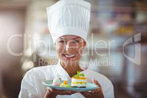 Portrait of chef presenting her food
