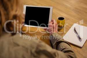Focus on tablet with hands