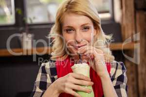 Young woman drinking mocktail