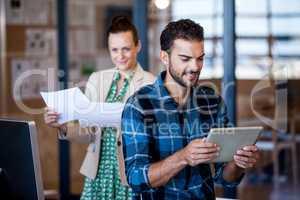 Coworkers looking different multimedias format