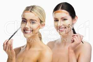 Women doing contouring on her face