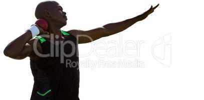 Profile view of sportsman practising shot put