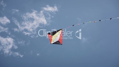 14-Colorful Kite Flying In The Blue Sky Slowmotion