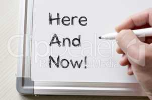 Here and now written on whiteboard