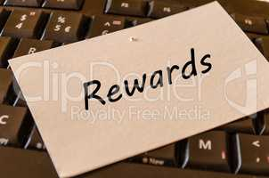 Rewards concept on keyboard background