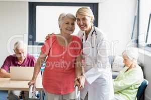Nurse helping senior with walking aid