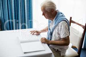 Senior man using braille to read