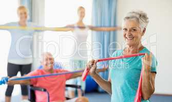 Seniors exercising with stretching bands