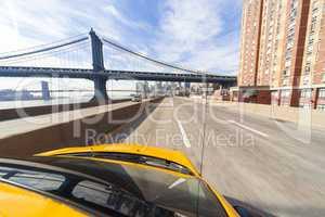 New York City Yellow Taxi Cab by Manhattan Bridge