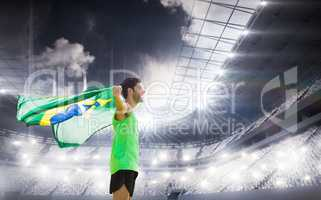 Composite image of profile view of brazilian sportsman is holdin